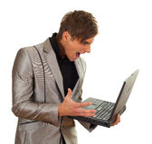 Furious young man keeping laptop Royalty Free Stock Photos