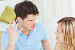 Furious young man working up against girlfriend Royalty Free Stock Photo