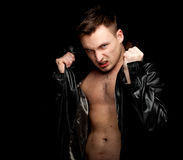 Furious young shirtless man in leather jacket Royalty Free Stock Image