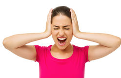 Furious Young Woman Covering Ears With Hands Royalty Free Stock Image