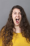 Furious young woman losing her temper Royalty Free Stock Image