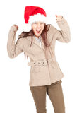 Furious young woman in red Christmas hat Stock Photos
