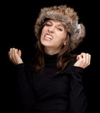 Furious young woman in white winter hat Royalty Free Stock Photo