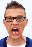Furiously young man Stock Images