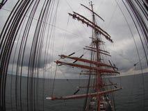 Furling sails aloft on tallship or sailboat Stock Photos