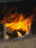 Furnace #1. Burning wood pieces in a furnace Royalty Free Stock Photo