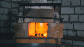 The furnace of a blacksmith engulfed in flames. In the forge Royalty Free Stock Image