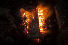 Furnace with charcoal and iron bar stock photography