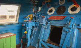 Furnace department of the retro train driver. Stove compartment of the driver`s cabin of a retro train royalty free stock photo