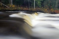 Furnace Falls In Autumn. A long exposure, water blur look at Furnace Falls, a small waterfall located in Central Ontario, Canada. A short waterfall, some would stock photos