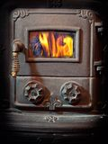 Furnace. Firebox door of a retro wood burning stove Royalty Free Stock Photography