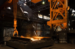 Furnace with Hot Liquid Metal. Furnace of a foundry with hot liquid metal stock photo