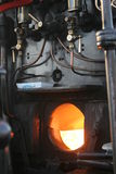 Furnance in steam train. A picture focusing on the glowing furnace in a steam train Stock Photography