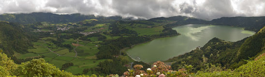 Furnas Lagoon, Azores. Furnas Valley showing the Furnas Lagoon, Furnas Town and green pastures, all under an heavy clouded sky. Azores, San Miguel, Portugal Stock Images