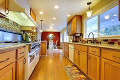 Furnished bright light brown kitchen room Stock Image