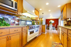 Furnished bright light brown kitchen room Stock Images