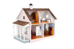 Furnished pink doll house on white Stock Images