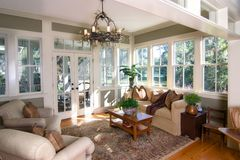 Furnished sunroom. Beautiful furnished sunroom with lots of windows and glass doors