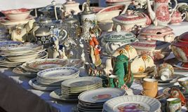 Furnishings and ceramic plates for sale vintage shop Stock Image