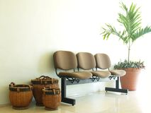 Furniture 01. View of a waiting room decorated qith three baskets and a plant Stock Image