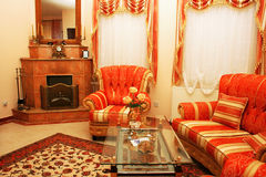 Furniture. Home interior with stylish furniture and fire-place Royalty Free Stock Images