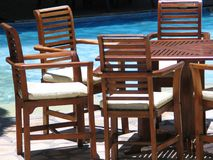 Furniture. Wooden Furniture by swimming pool Stock Image