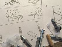 Furniture assembling process. From time to time we need to spend time in a process of installation and construction of something stock images