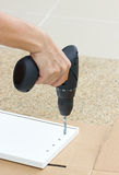 Furniture Assembling Using Battery Drill. Royalty Free Stock Photos