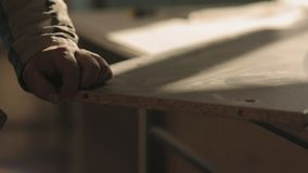 Furniture assembly, close-up man work with hummer stock footage