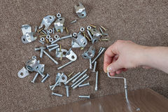 Furniture assembly hand tool, hex wrench screwed into furn Stock Image