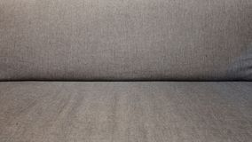 Close up a grey wool of luxury sofa stock image