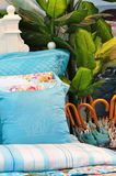 Furniture and bedding. Furniture and blue color bedding, with green plant beside, shown as comfortable life Royalty Free Stock Image