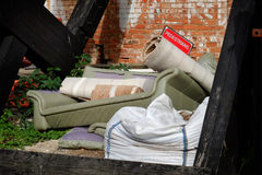 Furniture and carpet dumped. Royalty Free Stock Photo