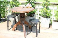 Furniture, chairs, planks and wooden tables, outdoor living corner, garden decoration. Furniture chairs planks wooden tables outdoor living corner garden royalty free stock photo