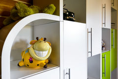 Furniture in the children`s room. White furniture with toys in the children`s room Stock Photo