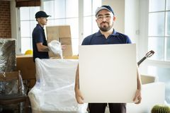 Furniture delivery man delivering furnitures Royalty Free Stock Photo