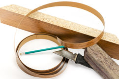 Furniture edges and TOOLS. Materials and tools for furniture production Royalty Free Stock Image