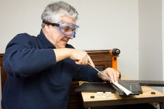 Furniture fitter. A man working as a jointer fitting some furniture Stock Photo