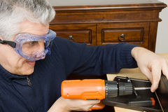 Furniture fitter. A man working as a jointer fitting some furniture Royalty Free Stock Photos
