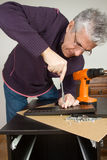 Furniture fitter. Building a desk with several tools of work Stock Images