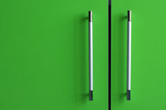 Furniture handles. Green furniture doors with chrome handles Stock Images