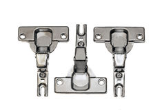 Furniture hardware - hinges on a white background Royalty Free Stock Images
