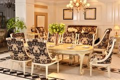 Furniture in luxury dining room stock images