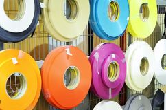 Furniture manufacture, multi-colored plastic tapes - raw materials. Close-up royalty free stock photo