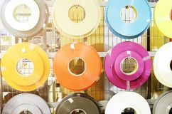 Furniture manufacture, multi-colored plastic tapes - raw materials. Tinted photo. Close-up stock images