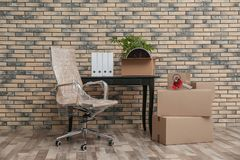 Furniture and moving boxes in office. Furniture and moving boxes in empty office stock photography