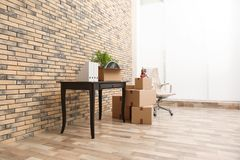 Furniture and moving boxes in office. Furniture and moving boxes in empty office stock image