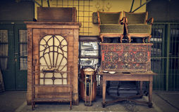 Furniture. Old home furniture in the middle of the street Royalty Free Stock Image