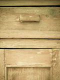 Furniture part. Closeup of wooden kitchen cabinet. Furniture part. Retro style. Closeup of vintage wooden kitchen cabinet or cupboard as background Royalty Free Stock Photo