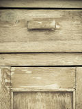 Furniture part. Closeup of wooden kitchen cabinet. Furniture part. Retro style. Closeup of vintage wooden kitchen cabinet or cupboard as background Royalty Free Stock Image